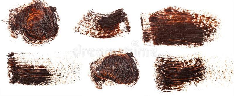 Tache de peinture brune d'huile sur le blanc positionnement image stock