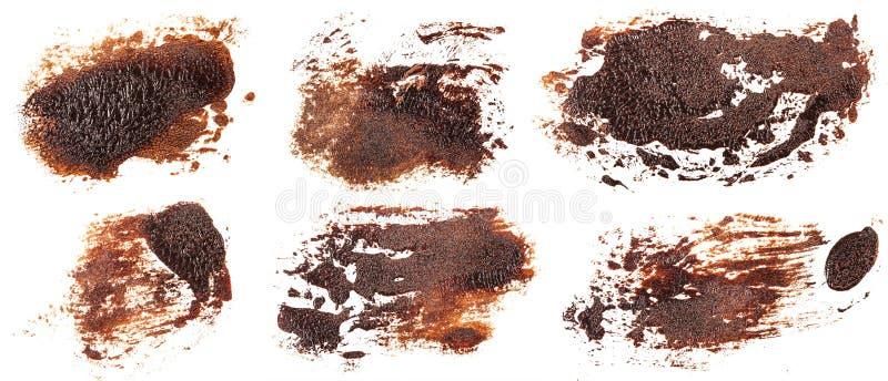Tache de peinture brune d'huile sur le blanc positionnement photo stock