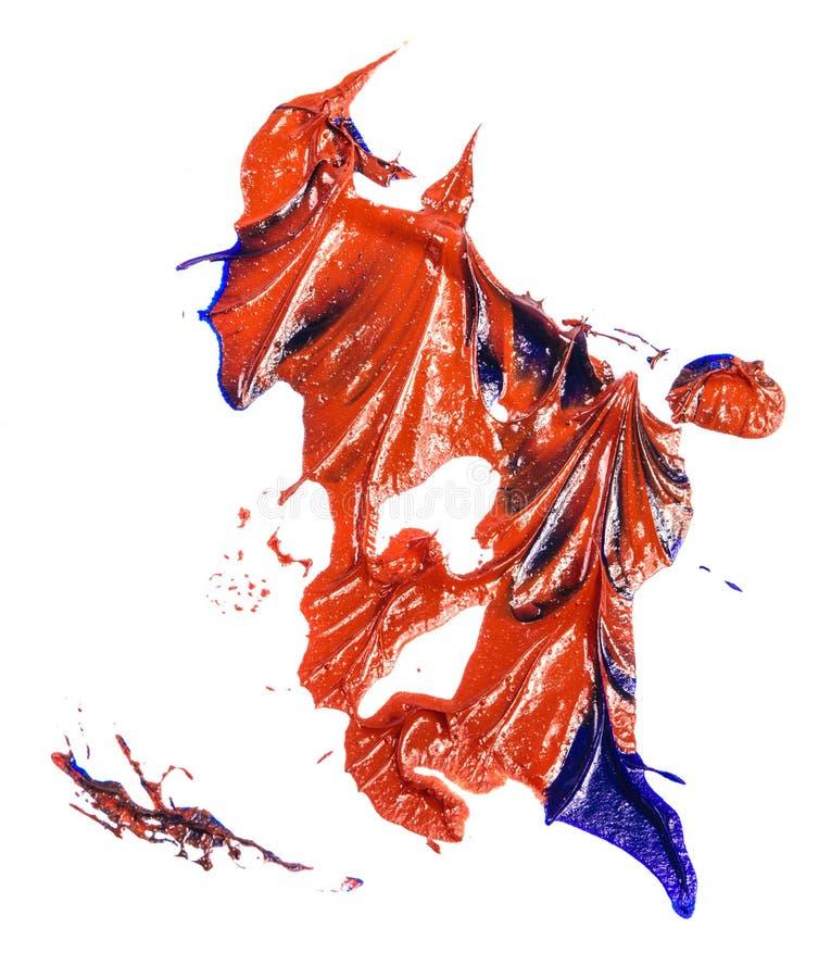 Tache de peinture ? l'huile bleue et rouge calomnie sur le blanc image stock