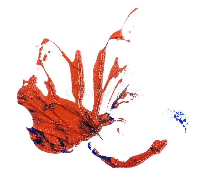 Tache de peinture ? l'huile bleue et rouge calomnie sur le blanc image libre de droits