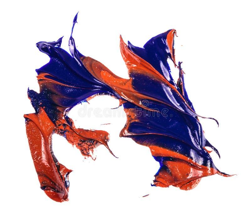 Tache de peinture ? l'huile bleue et rouge calomnie sur le blanc images libres de droits