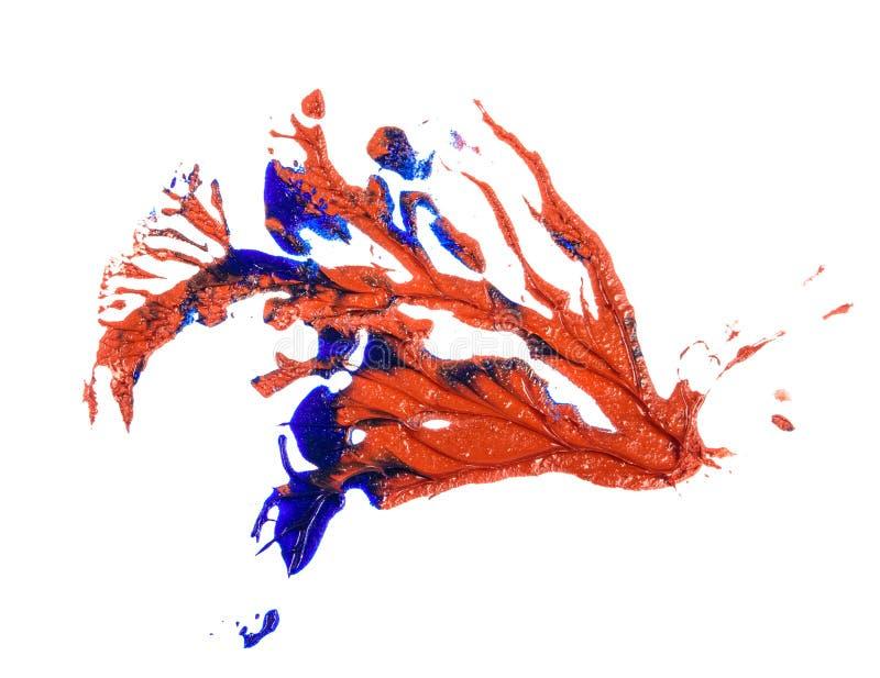 Tache de peinture ? l'huile bleue et rouge calomnie sur le blanc photo libre de droits