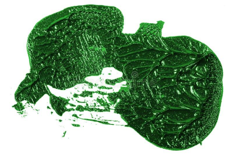 Tache de peinture verte d'huile sur le blanc photographie stock