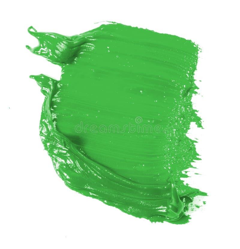 Tache de peinture verte d'huile sur le blanc images stock