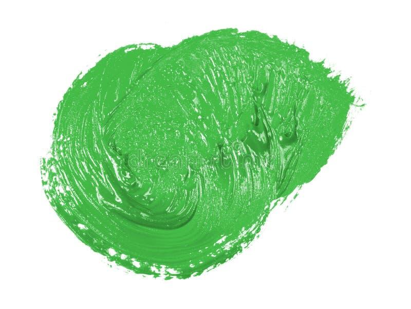 Tache de peinture verte d'huile sur le blanc photographie stock libre de droits