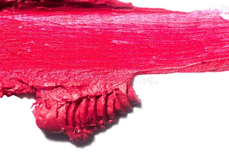 Tache rouge de fard ? paupi?res ou de bronzer d'isolement sur le fond blanc images libres de droits