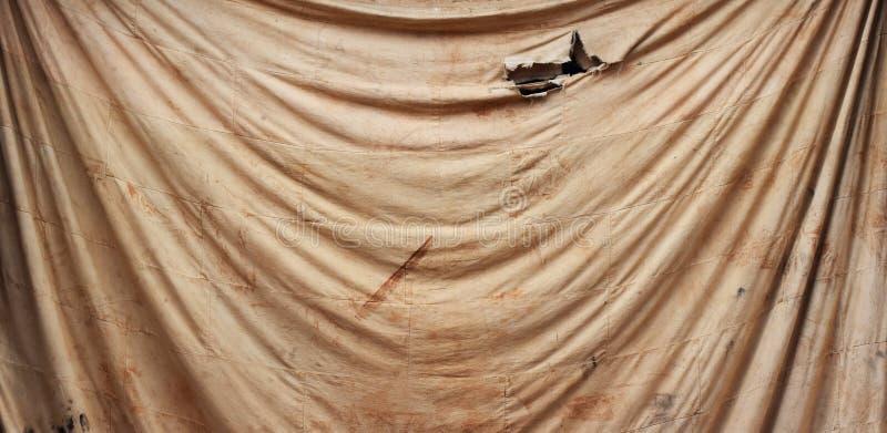 Tache sur le vieux tissu brun pour le fond photo stock