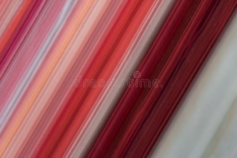 Taches floues de rouge des couches de papier photo libre de droits