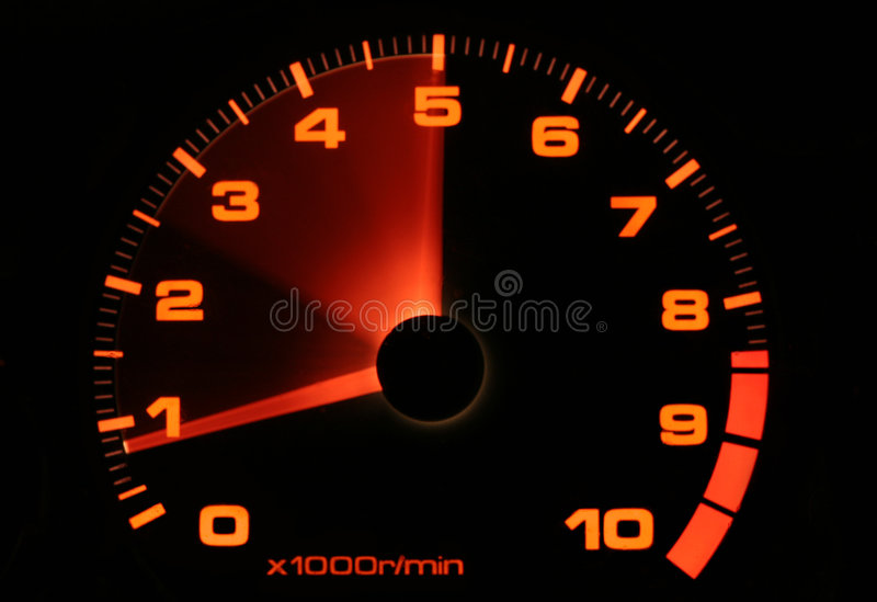 Tachometer revving up stock photo