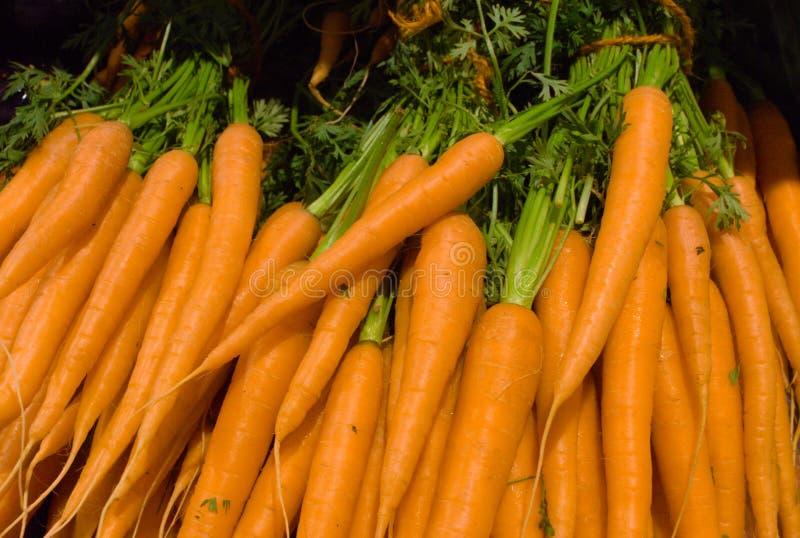 Tack of orange carrots in the supermarket stock photo