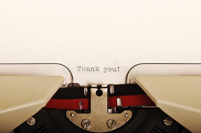 tacka den skrivavna skrivmaskinen dig arkivfoto