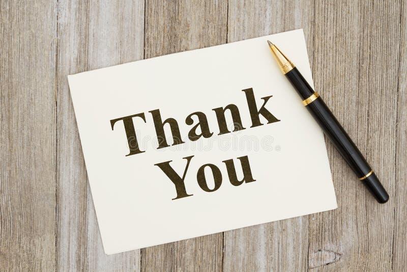 Tacka dig hälsningkortet med pennan arkivbilder