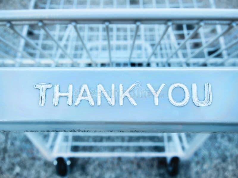 Tacka dig meddelandet på en shoppingvagn arkivbilder