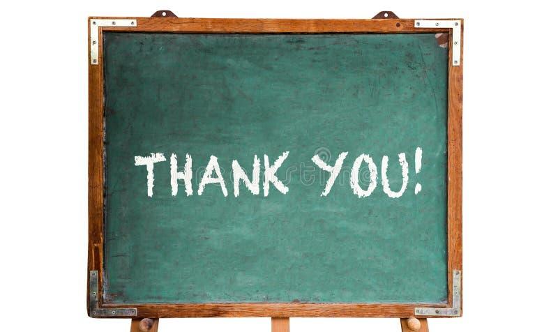 Tacka dig! textmeddelande i vita kritabokstäver som är skriftliga på ram för svart tavla eller för svart tavla för gammal grungy  arkivfoto