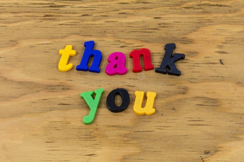 Tacka som dig, tackar färgteckenuttryckt plast- arkivfoto