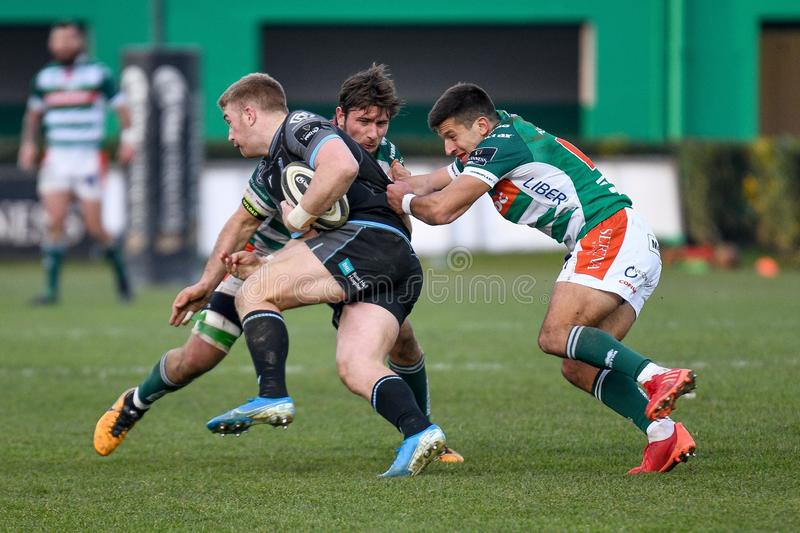 Rugby Guinness Pro 14 Benetton Treviso vs Glasgow Warriors. Tackle of giovanni pettinelli and tommaso allan (treviso) on kyle steyn (glasgow) during Benetton royalty free stock photos