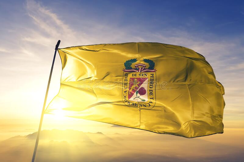 Tacna of Peru flag waving on the top sunrise mist fog. Tacna of Peru flag textile cloth fabric waving on the top sunrise mist fog royalty free stock image
