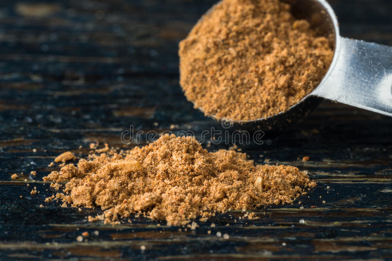 Taco Seasoning. Spilling from a measuring spoon stock photo
