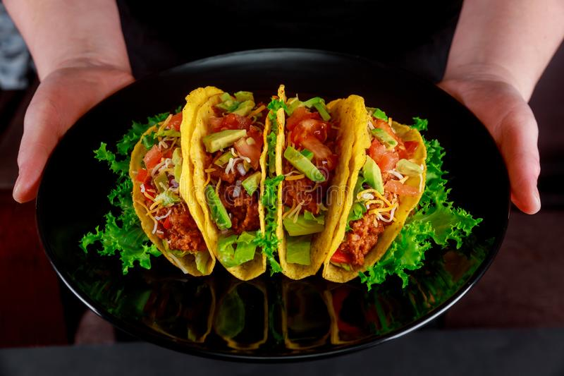 Taco traditional Mexican dish with wheat tortilla folded fresh salad, vegan and vegetarian stock photo