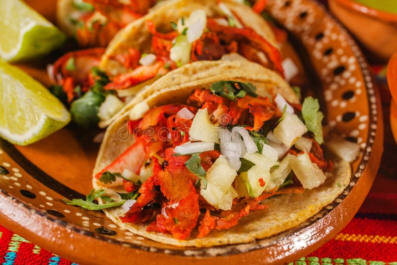 Tacos al pastor and lemon mexican spicy food in mexico city. Tacos al pastor mexico lemons mexican food tortilla, spicy mexico city royalty free stock photo