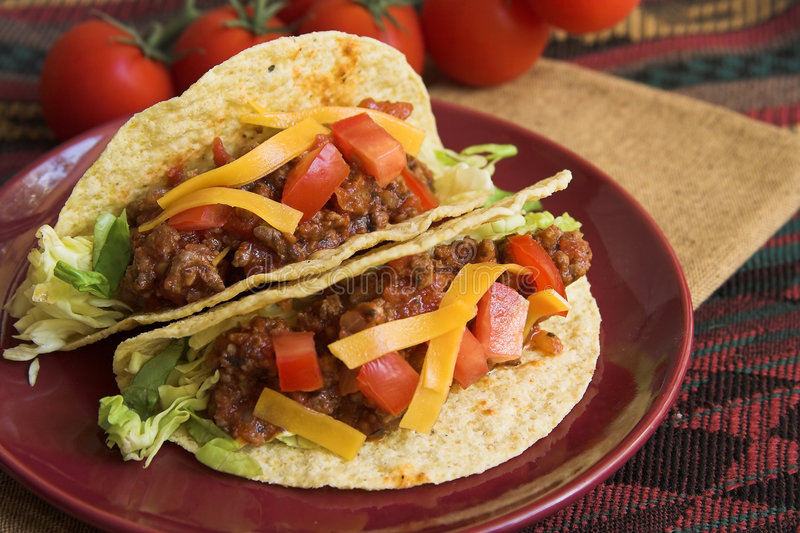 Tacos with cheese. Two tacos with cheese and tomatoes