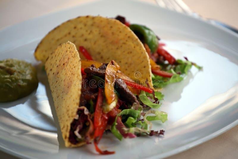 Tacos d'une plaque photographie stock