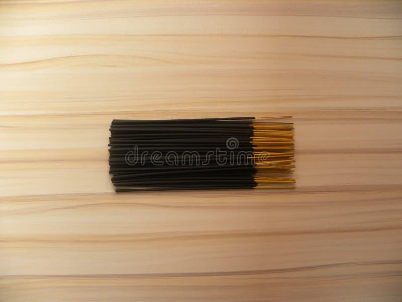 Tacos de madeira fina preta Incense imagem de stock