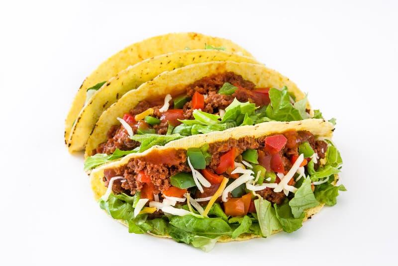 Tacos mexicain traditionnel avec de la viande et des légumes, d'isolement photo stock