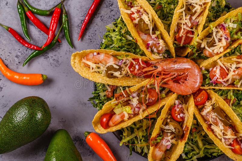 Tacos with shrimp, lettuce, cheese and jalapeno. Tacos with shrimp, lettuce, cheese and jalapeno, top view stock photos