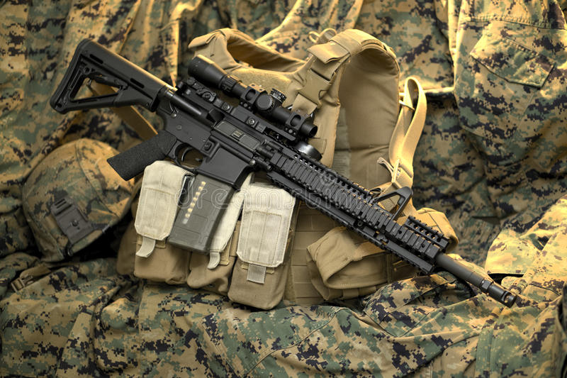 Tactical Rifle resting on vest royalty free stock images