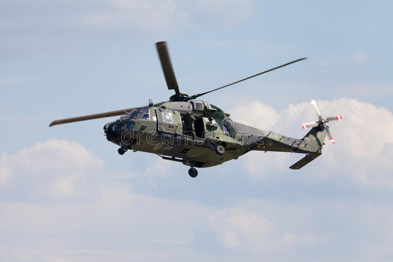 Tactical troop helicopter NH90. BERLIN / GERMANY - JUNE 3 2016: tactical troop helicopter NH90 from nato helicopter industries flies in berlin, germany on june 3 royalty free stock image