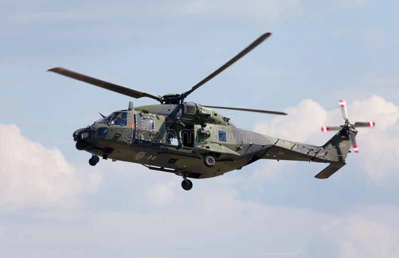 Tactical troop helicopter NH90. BERLIN / GERMANY - JUNE 3 2016: tactical troop helicopter NH90 from nato helicopter industries flies in berlin, germany on june 3 stock photography