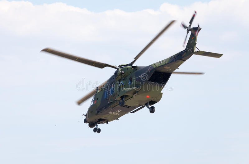 Tactical troop helicopter NH90. BERLIN / GERMANY - JUNE 3 2016: tactical troop helicopter NH90 from nato helicopter industries flies in berlin, germany on june 3 royalty free stock images