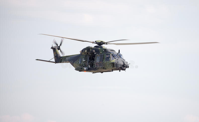 Tactical troop helicopter NH90. BERLIN / GERMANY - JUNE 3 2016: tactical troop helicopter NH90 from nato helicopter industries flies in berlin, germany on june 3 stock photos