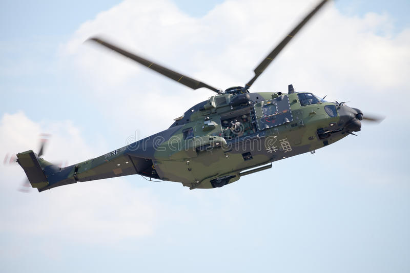 Tactical troop helicopter NH90. BERLIN / GERMANY - JUNE 3 2016: tactical troop helicopter NH90 from nato helicopter industries flies in berlin, germany on june 3 royalty free stock photography