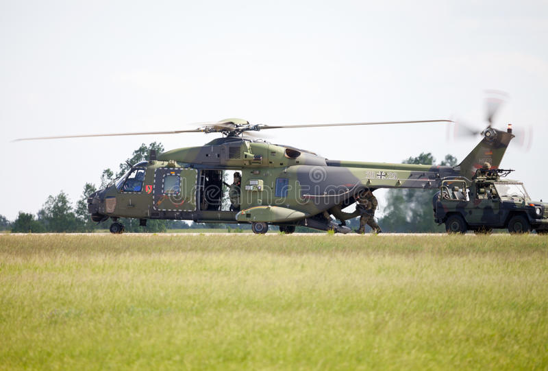 Tactical troop helicopter NH90. BERLIN / GERMANY - JUNE 3 2016: tactical troop helicopter NH90 from nato helicopter industries flies in berlin, germany on june 3 royalty free stock photo