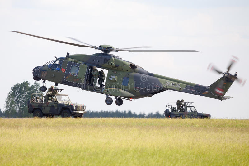 Tactical troop helicopter NH90. BERLIN / GERMANY - JUNE 3 2016: tactical troop helicopter NH90 from nato helicopter industries flies in berlin, germany on june 3 stock image