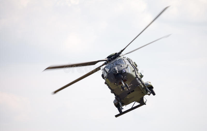 Tactical troop helicopter NH90. BERLIN / GERMANY - JUNE 3 2016: tactical troop helicopter NH90 from nato helicopter industries flies in berlin, germany on june 3 stock photo
