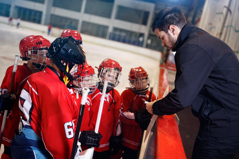 Tactics coach in game hockey in ice. Matches stock photo