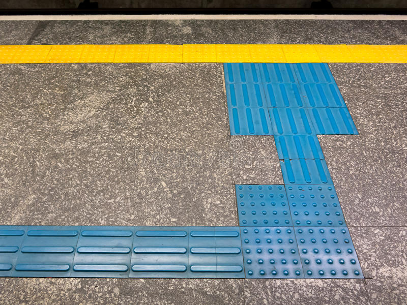 Tactile Ground Surface Indicators. For visually impaired in brazilian subway station stock photo
