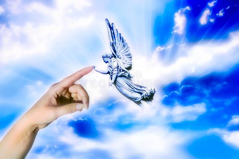 Tacto del ángel imagen de archivo