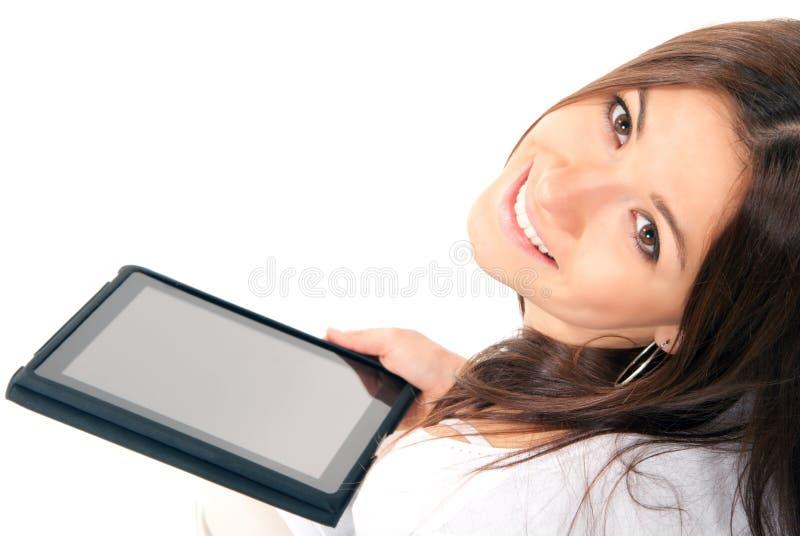 Tacto electrónico de la tablilla del asimiento de la mujer nuevo fotografía de archivo libre de regalías