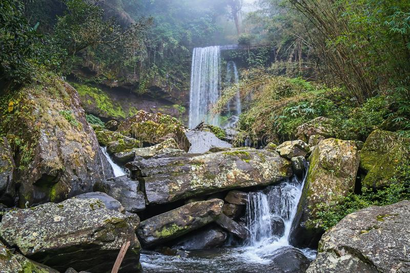 Tad Tiger Waterfall is a small waterfall in the area of  Boloven, Laos. Must walk on foot to see the waterfall royalty free stock photo