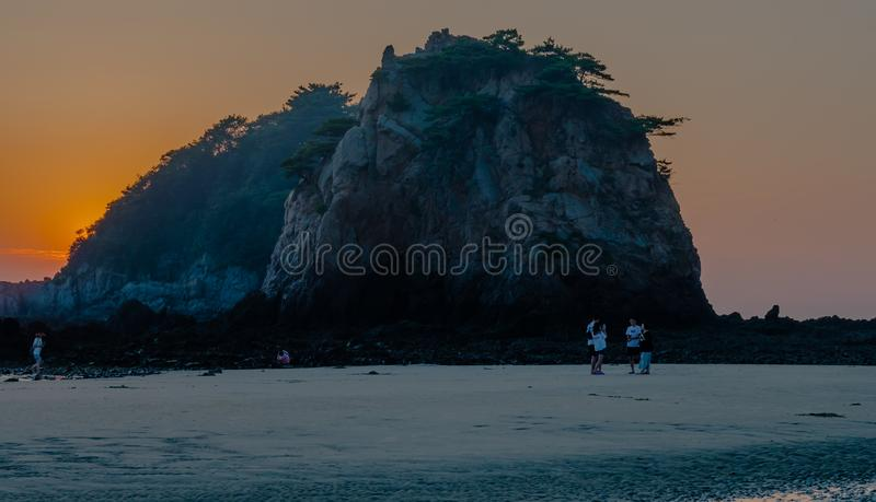 Asian people talking on beach royalty free stock photos