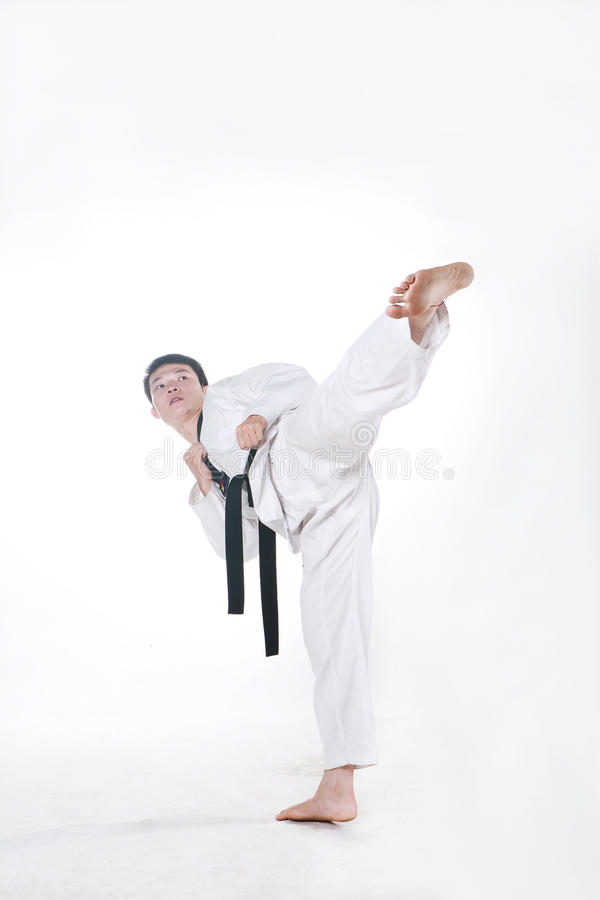 Taekwondo. Asian man playing with taekwondo stock images