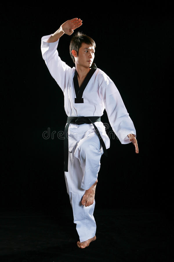 Taekwondo. Asian man playing with taekwondo stock photography
