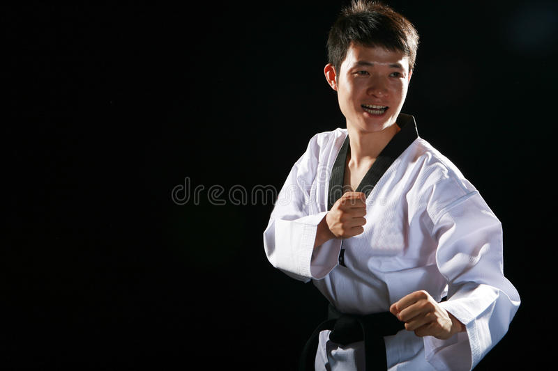 Taekwondo. Asian man playing with taekwondo royalty free stock photography