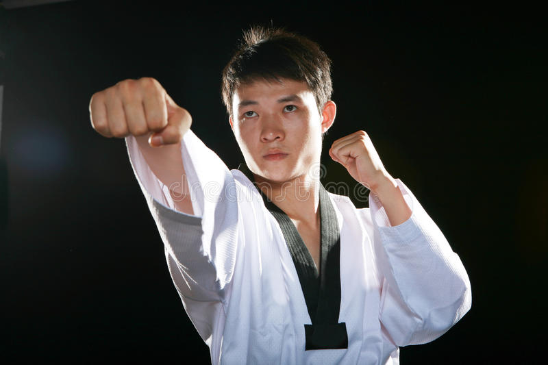 Taekwondo. One asian man is playing with taekwondo royalty free stock photography