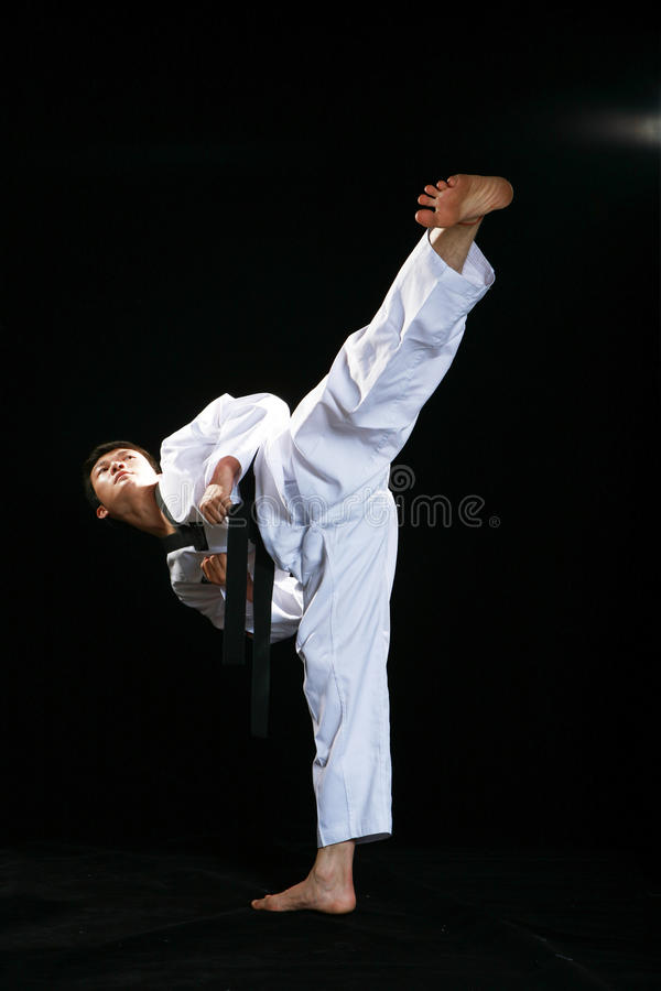 Taekwondo. Asian man playing with taekwondo royalty free stock images