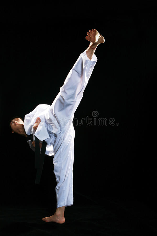 Taekwondo. One asian man is playing with taekwondo royalty free stock photo